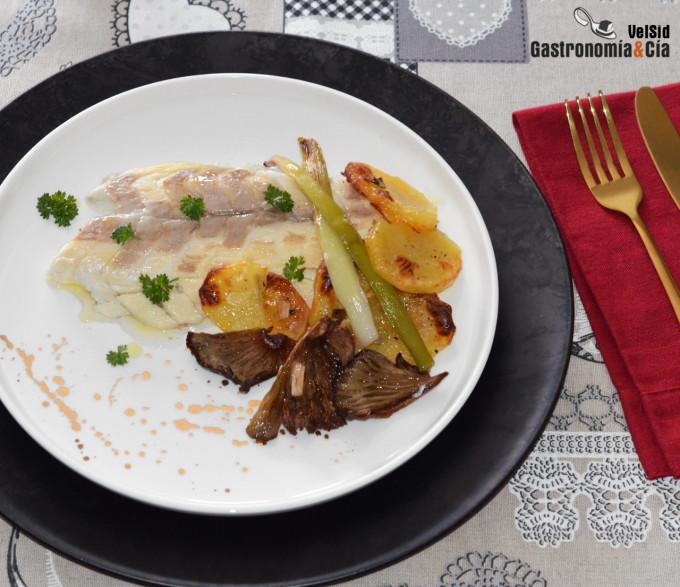 Lubina salvaje al horno con patatas y ajos tiernos