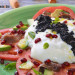 Burrata con aguacate, anchoas y huevas de arenque ahuma