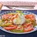 Burrata con tomate verde a la parrilla y salsa romesco