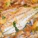 Corvina al horno con setas de ostra y limón encurtido
