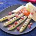 Espárragos blancos frescos a la parrilla con salsa rome