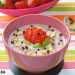 Porridge con fresas calientes