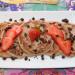 Tortitas de avena con plátano, fresas y chocolate