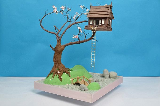 Pastel cabaña en el árbol